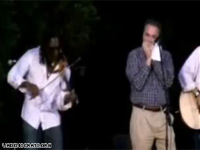Tim Kaine, right, performed at a fundraiser along with Boyd Tinsely of the Dave Matthews Band.