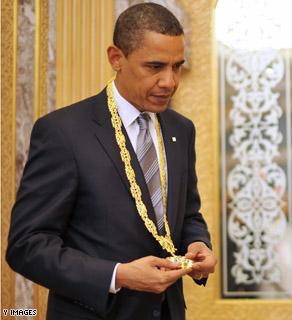 US President Barack Obama holds the King Abdul Aziz Order of Merit after it was presented to him by Saudi King Abdullah bin Abdul Aziz al-Saud.