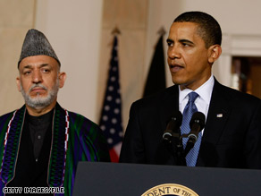 President Obama, pictured in this file photo with Afghan President Hamid Karzai, said Tuesday that the U.S. seeks an enduring partnership with the Afghan people.