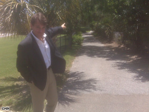 David Mattingly stands at the end of the driveway to Gov. Sanford's beach house.