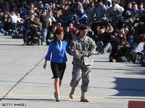 Palin (here visiting son Track's Army brigade) plans to visit members of the Alaska National Guard.