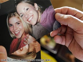 Steve Babcock shows a photograph of his daughter Trisha, at right, and a friend. The 2003 Davison High School graduate had planned to attend Mott Community College in Flint this fall and become a nurse, he said.