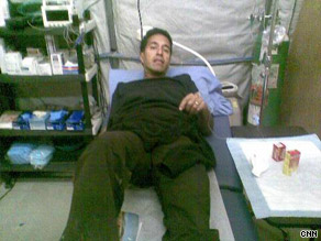 Dr. Sanjay Gupta, contracted H1N1 in Afghanistan, receives treatment.