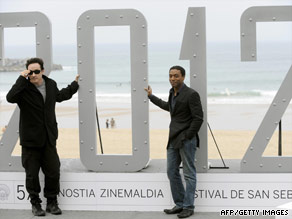 Actors John Cusack and Chiwetel Ejiofor pose to promote Emmerich's latest film 2012.