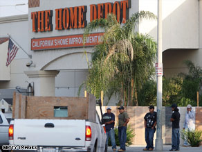Day laborers wait in front of a Home Depot in Los Angeles.