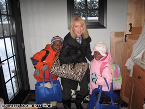Scotti Keepman at home with her  adopted children.