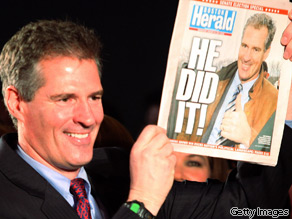 Republican Scott Brown shows off a headline touting his win Tuesday night.