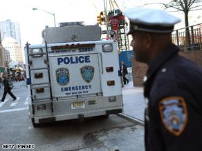 New York City police officers guard lower Manhattan, near Ground Zero.