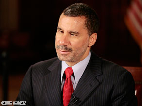 David Paterson lashed out Wednesday at a published report alleging a top aide's history of drug arrests and alleged domestic violence..