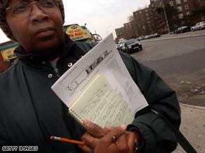 A job seeker stands outside an employment office in Brooklyn, New York.