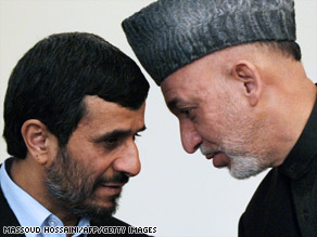 Afghan President Hamid Karzai (R) speaks with visiting Iranian President Mahmoud Ahmadinejad moments before a joint press conference at the presidential palace in Kabul on March 10, 2010.