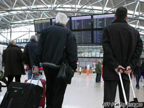 Passengers look at a time table announcing cancelled flights at the airport in Hamburg, Germany, on April 16, 2010.