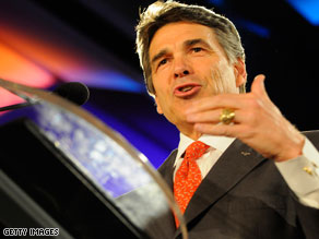 Gov. Rick Perry of Texas said Friday he has concerns with portions of the law passed in Arizona.