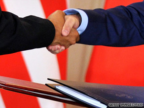 President Obama and Russian President Dmitry Medvedev shake hands after signing the Strategic Arms Reduction Treaty on April 8.