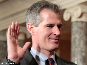 FILE PHOTO: Scott Brown (R-MA) participates in a ceremonial swearing-in February 4, 2010 on Capitol Hill after winning a special election for the seat that was held by the late Ted Kennedy.