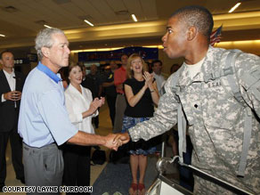 Former President George W. Bush surprised soldiers returning home mainly from Iraq and Afghanistan at Dallas Fort Worth International Airport on Thursday.