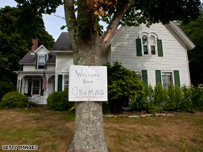 A sign posted on a tree near the Obama's vacation location reads: 'Welcome back Obamas.'