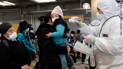 A girl is checked for possible radiation exposure in Japan.