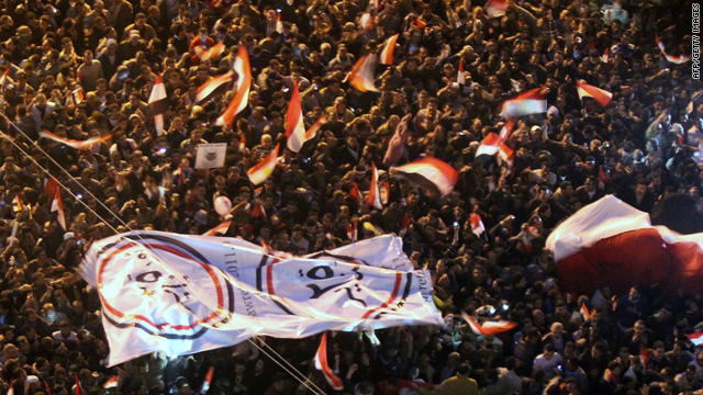 Thousands of Egyptians in Cairo celebrate President Hosni Mubarak's resignation Friday night.