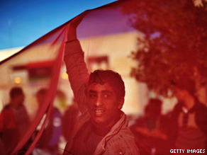 A Libyan anti-government protester takes part in an anti-Gadhafi demonstration.