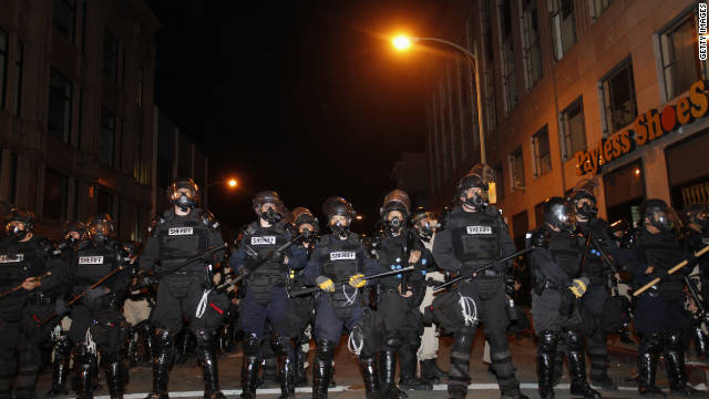 Oakland, California, police form a line to disperse protesters who barricaded themselves on a street near Oakland City Hall early Thursday, November 3. Police say they fired tear gas at demonstrators after a crowd threw rocks and shot fireworks at officers.