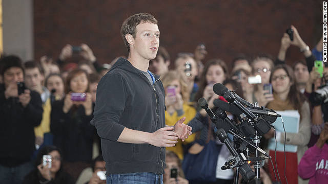 Harvard students gather around Facebook founder and CEO Mark Zuckerberg Monday afternoon.