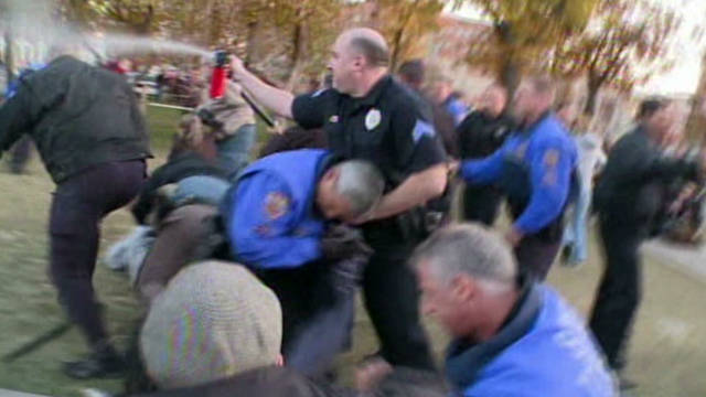 Occupy Denver protesters clash with police Wednesday.