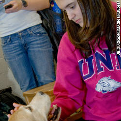 Student Taylor Frarie takes a break with a study buddy.
