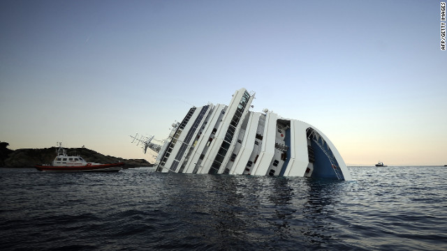 Photos: Cruise ship runs aground off Italy