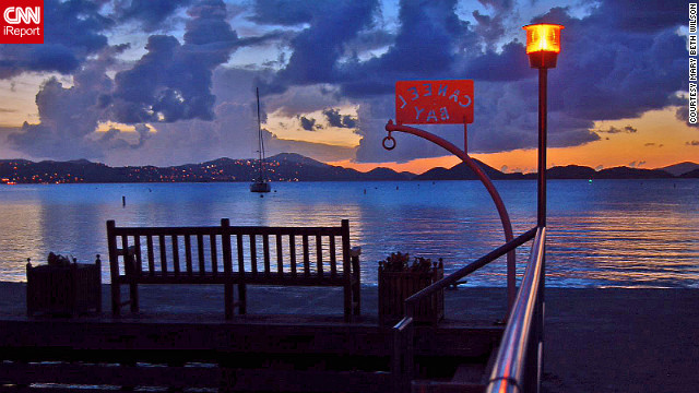 "<br/>Mary Beth Wilson captured this picturesque view of St. Thomas at sunset from Caneel Bay Resort on St. John. ""We feel at home there."""