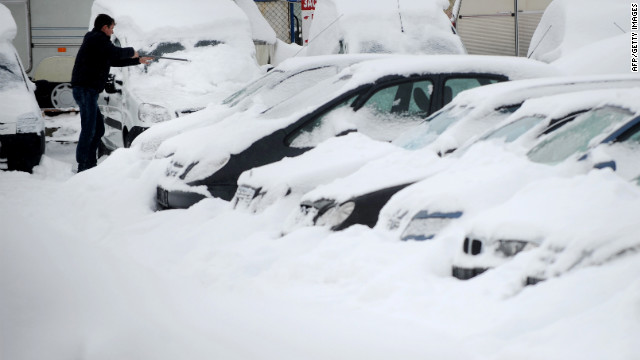 <br/>A man clears snow off a vehicle in Sofia, Bulgaria, on Friday, January 27.