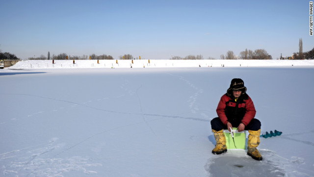 <br/>An ice fisherman waits for a catch on a frozen lake near Sofia, Bulgaria, on Monday, January 30.