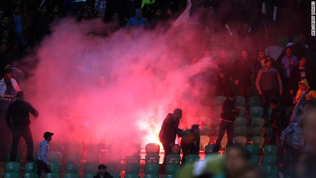 Flares are thrown in the stadium during clashes that erupted after a football match between Egypt's Al-Ahly and Al-Masry teams in Port Said, 220 kms northeast of Cairo, on February 1, 2012. At least 40 people were killed and hundreds injured according to medical sources.