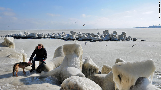 <br/>A man pets a dog next to frozen sea waters in Constanta, Romania, on Wednesday, February 1. Temperatures plunged to -34 degrees Celsius (-29 degrees Fahrenheit) in central Romania, where eight people died due to cold-related causes, according to local media.