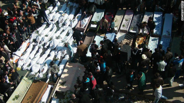 Syrian activists say this photo shows a mass funeral February 4 in Homs after they say the regime killed more than 200 people.