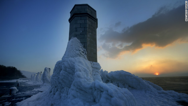 <br/>Lighthouse and lampposts are covered with heavy ice in central Adriatic Croatian port of Senj, some 200 kilometres from Zagreb, as the sun sets on February 8, 2012. There are more than 100 villages still trapped by snow in remote, mountain parts in Croatia.