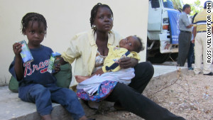 Natacha Polissaint and her children will live with family when they get back to Haiti because her house fell in the earthquake.