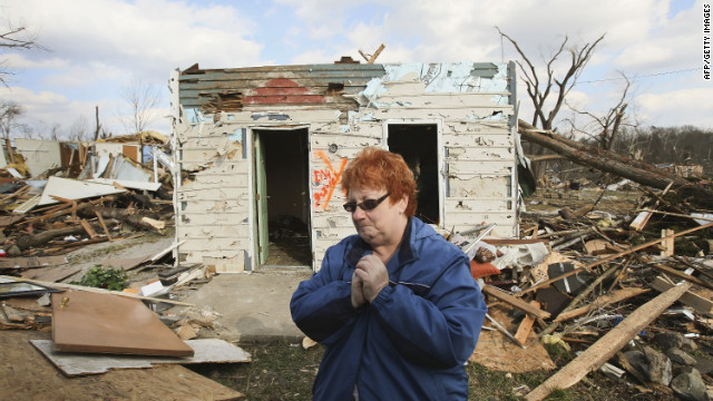 <br/>Janet Clark stands in front of her home on Sunday, March 4, where she rode out Friday's EF4 tornado in Henryville, Indiana.