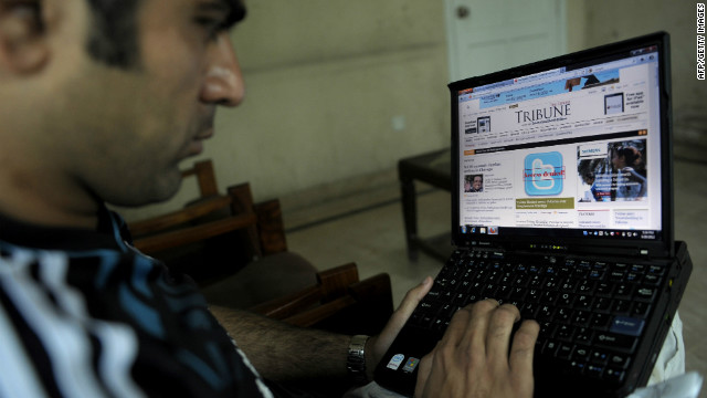 A Pakistani resident browses a newspaper website on Sunday, after the country's government blocked access to Twitter.