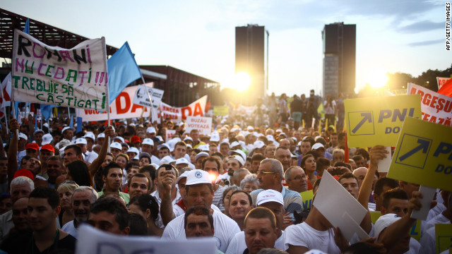 Supporters of Romanian PM Victor Ponta listen to him at a rally in Bucharest Thursday in favor of impeaching the president.