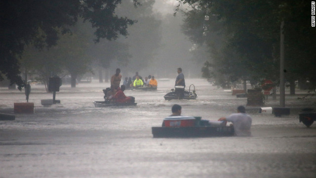 Rescue workers transport residents trapped by rising water from Isaac in LaPlace, Louisiana, on Wednesday, August 29. Officials warn of continued threats from storm surges and flooding as the hurricane-turned-tropical storm moves inland.