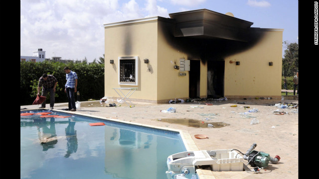 People inspect the damage at the U.S. Consulate in Benghazi, Libya, on Wednesday.