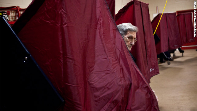 A man exits a voting booth at a fire station in Point Pleasant, New Jersey. As the New Jersey coastline continues to recover from Superstorm Sandy, numerous polling stations have had to merge and relocate due to storm damage and power outages.