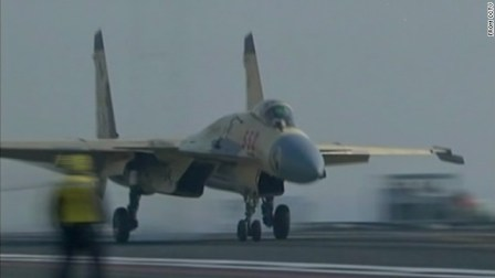 China announced Sunday that it had landed a fighter jet on the deck of an aircraft carrier for the first time.