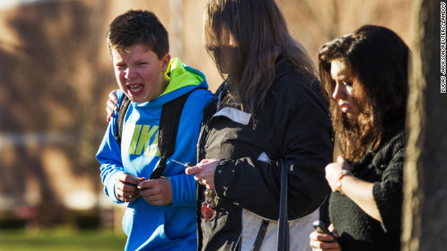 A boy weeps at Reed Intermediate School after getting news of the shooting at Sandy Hook Elementary School on December 14.