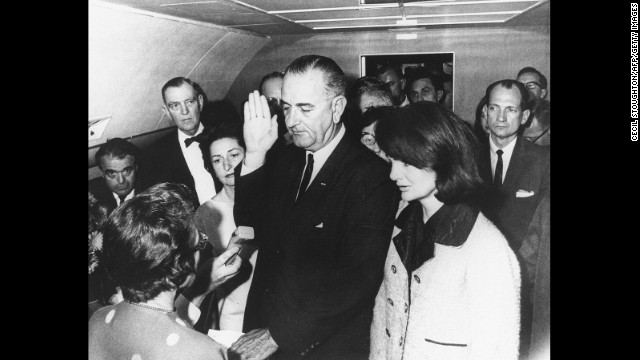 Lyndon B. Johnson takes the oath of office on November 22, 1963, after the assassination of President John F. Kennedy. Kennedy's widow, Jacqueline, stands at Johnson's side. U.S. District Judge Sarah T. Hughes swore in Johnson on Air Force One.