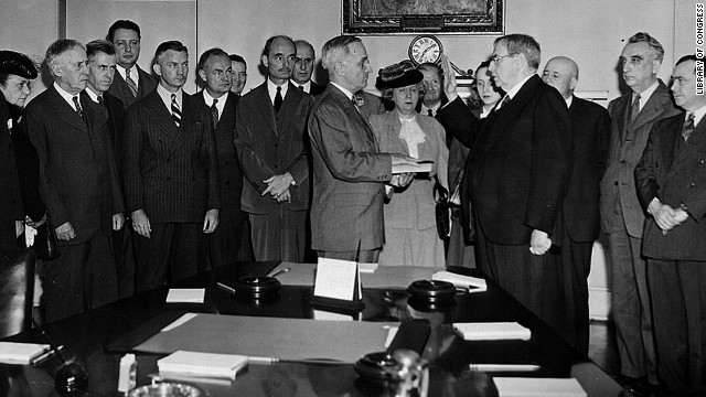 Chief Justice Harlan F. Stone administers the oath of office to Harry S. Truman in the Cabinet Room of the White House on April 12, 1945, after death of President Franklin D. Roosevelt.