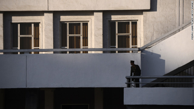 A North Korean soldier stands on a balcony in Pyongyang on April 16, 2012.