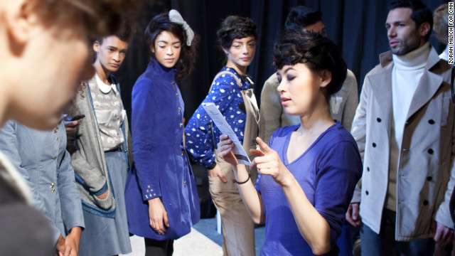 Surrounded by models, designer Leanne Mai-ly Hilgart directs her first Fashion Week show. She started Vaute Couture in 2008 and has earned a global following.