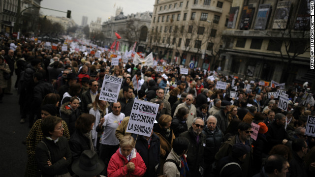 Protesters take part in a demonstration against plans to cut medical spending and privatize hospital services in Madrid of February 17, 2013.